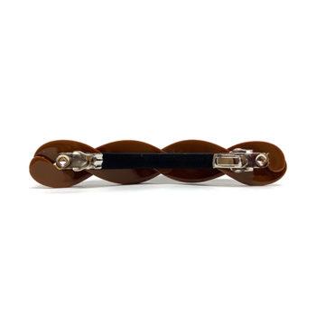 Bagside på twisted hårspænde i brun