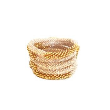 Nepal armbånd med sart rosa og guld perler