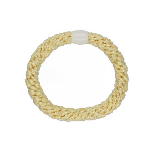 Billede af glitter hårelastik i pastel gul med hvid perle