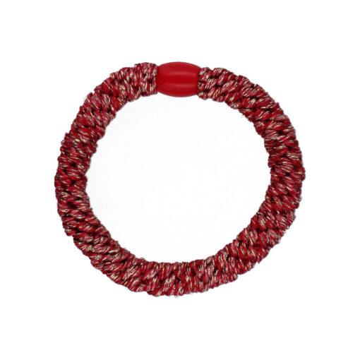 Produktbillede af flettet hårelastik i glitter mørkerød med rød plast perle